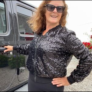 Black bomber jacket with shiny sequins